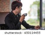 thoughtful handsome businessman ...   Shutterstock . vector #650114455