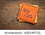 Small photo of Pareto principle or eighty-twenty rule represented on a sticky note against rustic wood - a reminder or advice