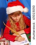 young girl in santa s hat... | Shutterstock . vector #65015050