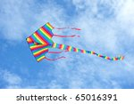 Colorful Kite Against Clear Blue Sky - stock photo