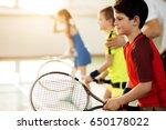 Excited children playing tennis ...
