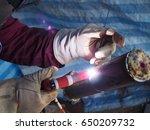 welder is welding on test... | Shutterstock . vector #650209732