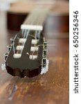 Small photo of Old Guitar Headstock on rustic background