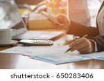 a business woman analyzing... | Shutterstock . vector #650283406