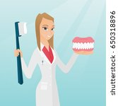 caucasian dentist showing a... | Shutterstock .eps vector #650318896