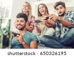 friends having fun on the couch ... | Shutterstock . vector #650326195
