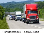 a red semi leads a line of... | Shutterstock . vector #650334355