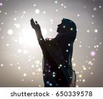 silhouette muslim arabic woman... | Shutterstock . vector #650339578