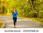 young woman running in the... | Shutterstock . vector #650356816