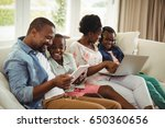 smiling parents and kids using... | Shutterstock . vector #650360656