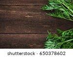 green grass on a wooden... | Shutterstock . vector #650378602