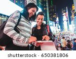 girls in new york looking at a... | Shutterstock . vector #650381806