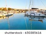 Small photo of boats reflected on sea at Marina Alimos Attica Greece