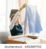 young beautiful woman on living ... | Shutterstock . vector #650389702