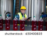 male factory worker monitoring... | Shutterstock . vector #650400835