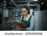 female factory worker... | Shutterstock . vector #650400838