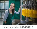 portrait of female factory... | Shutterstock . vector #650400916