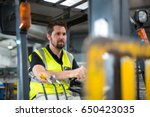 factory worker driving forklift ... | Shutterstock . vector #650423035