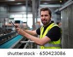 portrait of smiling factory... | Shutterstock . vector #650423086