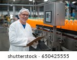 portrait of smiling factory... | Shutterstock . vector #650425555