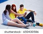 three young friends watch movie ... | Shutterstock . vector #650430586