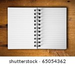 Open two blank white note book horizontal on teak wood background - stock photo