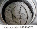 roll up the duvet put in a... | Shutterstock . vector #650566528