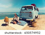 woman is sitting on the beach... | Shutterstock . vector #650574952