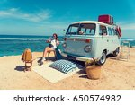 woman is sitting on the beach... | Shutterstock . vector #650574982