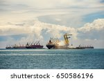 shipping unloading in the ocean.... | Shutterstock . vector #650586196