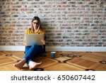 young woman working at home on... | Shutterstock . vector #650607442