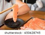 eating salmon sashimi with... | Shutterstock . vector #650628745
