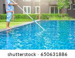 man cleaning the swimming pool | Shutterstock . vector #650631886