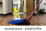 Janitors cleaning mop bucket...