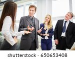 negotiation meeting between... | Shutterstock . vector #650653408