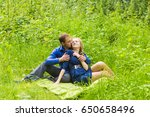 young couple in love outdoor | Shutterstock . vector #650658496