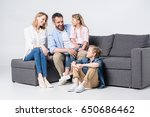 happy young family with two... | Shutterstock . vector #650686462