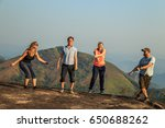 group of tourists jumping on... | Shutterstock . vector #650688262