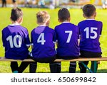 young boys sitting on soccer... | Shutterstock . vector #650699842
