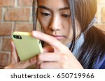 young asian woman using mobile... | Shutterstock . vector #650719966