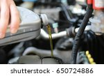 motor oil pouring  close up | Shutterstock . vector #650724886