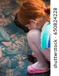 Girl Looks For Sea Creatures I...