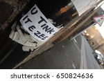 Small photo of A sticker on a drainpipe in Eton, Berkshire - U TINK IT EZEE