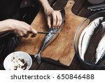 woman preparing mackerel fish | Shutterstock . vector #650846488