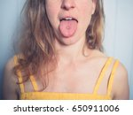 a young woman is showing her... | Shutterstock . vector #650911006