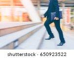 businessman running up the... | Shutterstock . vector #650923522