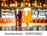 glass of light and dark beer on ... | Shutterstock . vector #650925802