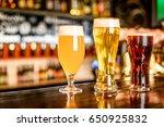 the beer assortment in pub | Shutterstock . vector #650925832
