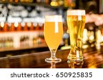 a two glass of light beer on a... | Shutterstock . vector #650925835