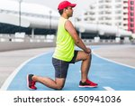 athletic runner stretching and... | Shutterstock . vector #650941036